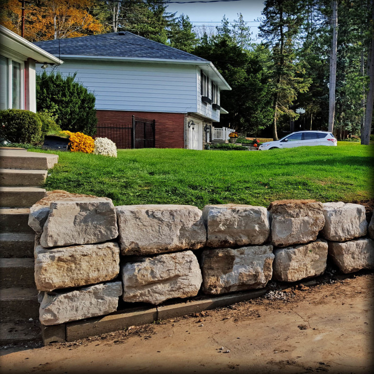 2016.03.03-A-Pro-Xcavation-Retaining-Wall-Land-Scape-Stone-Wall-Driveway-Armor-Stone-Square-Crop-768x768